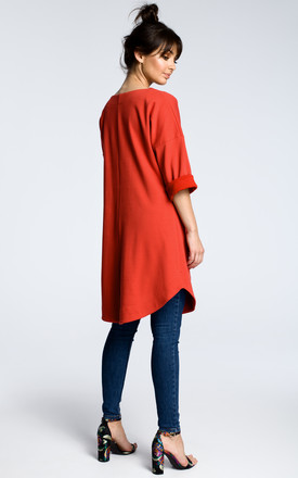 Red oversized tunic top with front pockets by MOE