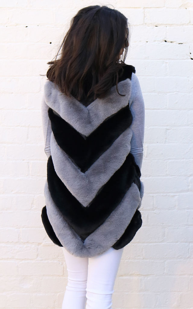 Luxe Two Tone Longline Diagonal Panelled Faux Fur Sleeveless Gilet in Grey & Black by One Nation Clothing