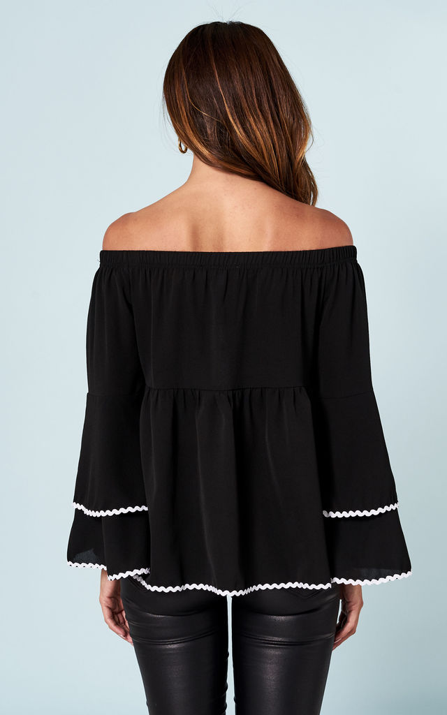 Black off the shoulder top with white trim by Bella and Blue