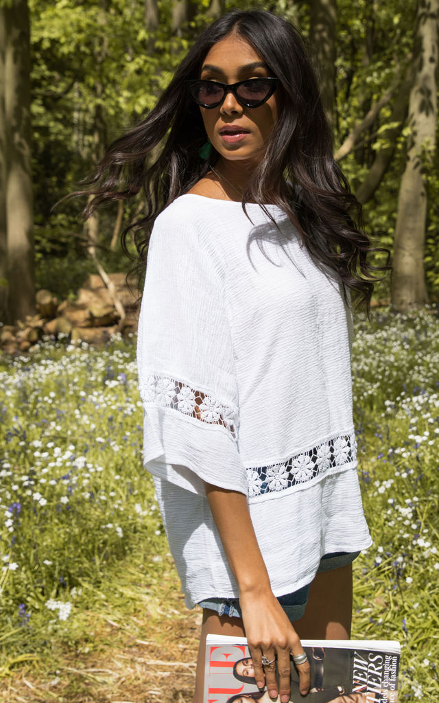 White oversized crochet detail top by Bella and Blue
