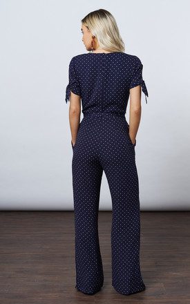 NAVY TIE SLEEVE POLKA DOT JUMPSUIT by If By Sea