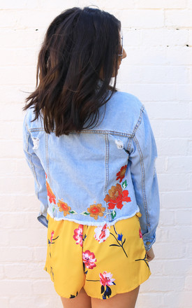 Floral Embroidered Hacked Off Cropped Denim Jacket in Light Blue by One Nation Clothing