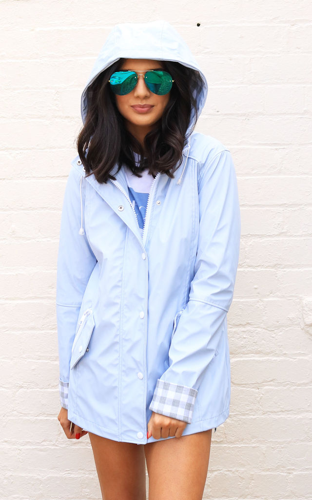 Kimmy Matte Rubberised Hooded Raincoat Mac in Baby Blue by One Nation Clothing