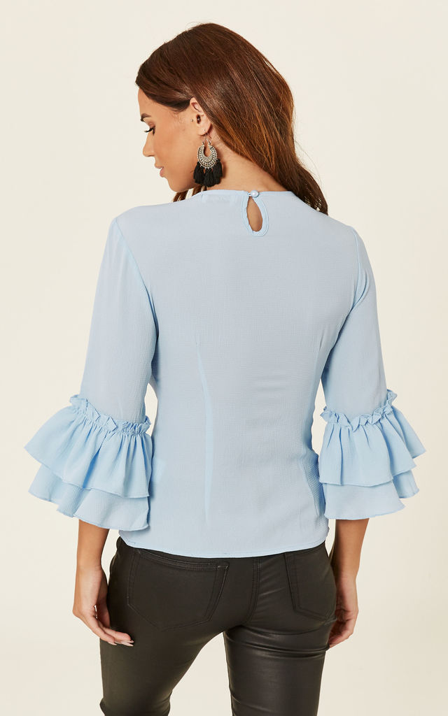 Ruffle Sleeve Blouse In Pastel Blue by Madam Rage