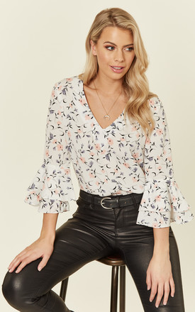 Ivory Floral Bell Sleeve Top by MISSI LONDON Product photo