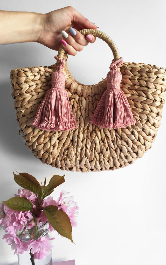 Rounded straw tassel bag by Rianna Phillips