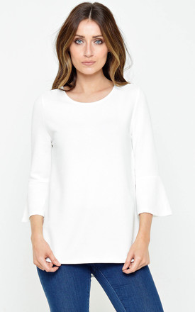 Kendra Flare Sleeve Ribbed Top in White by Marc Angelo