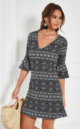 BLACK GEOMETRIC KNIT CREPE DRESS WITH DOUBLE BELL SLEEVE by The Vanity Room