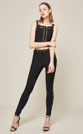 EIIVENLA Bandage Trousers and cropped top set with gold detail in Black by Amy Lynn