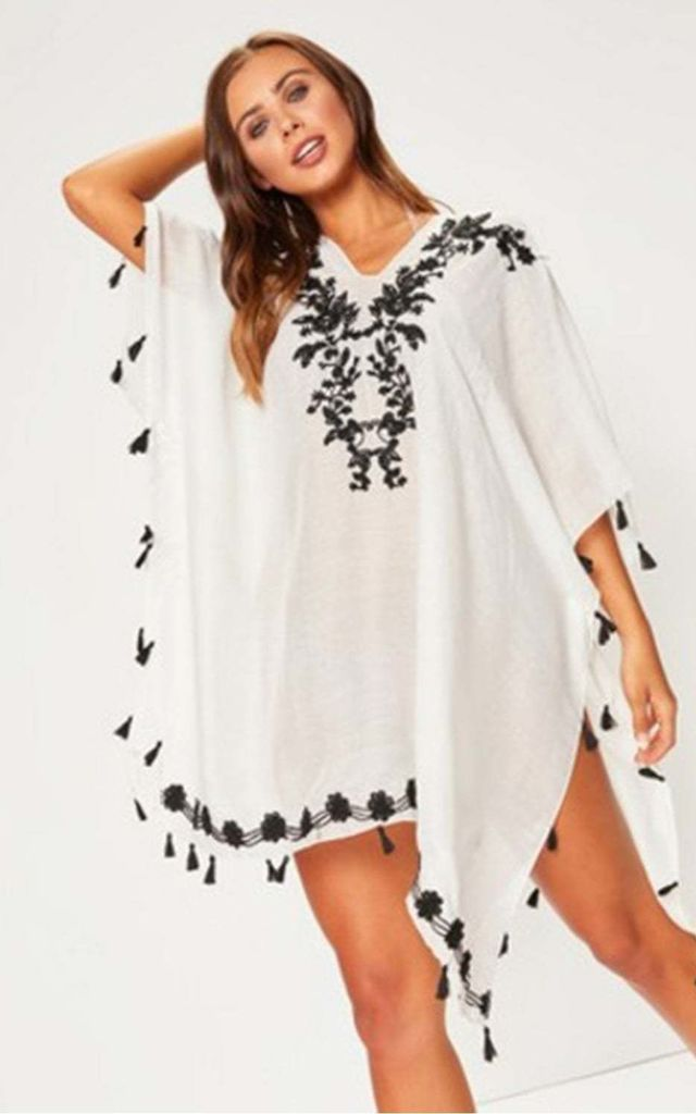 Black Floral Embroidered Kaftan Top with Tassel Detail by Urban Mist