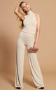The Aurora Jumpsuit in Soft Beige by Gorgeous Couture