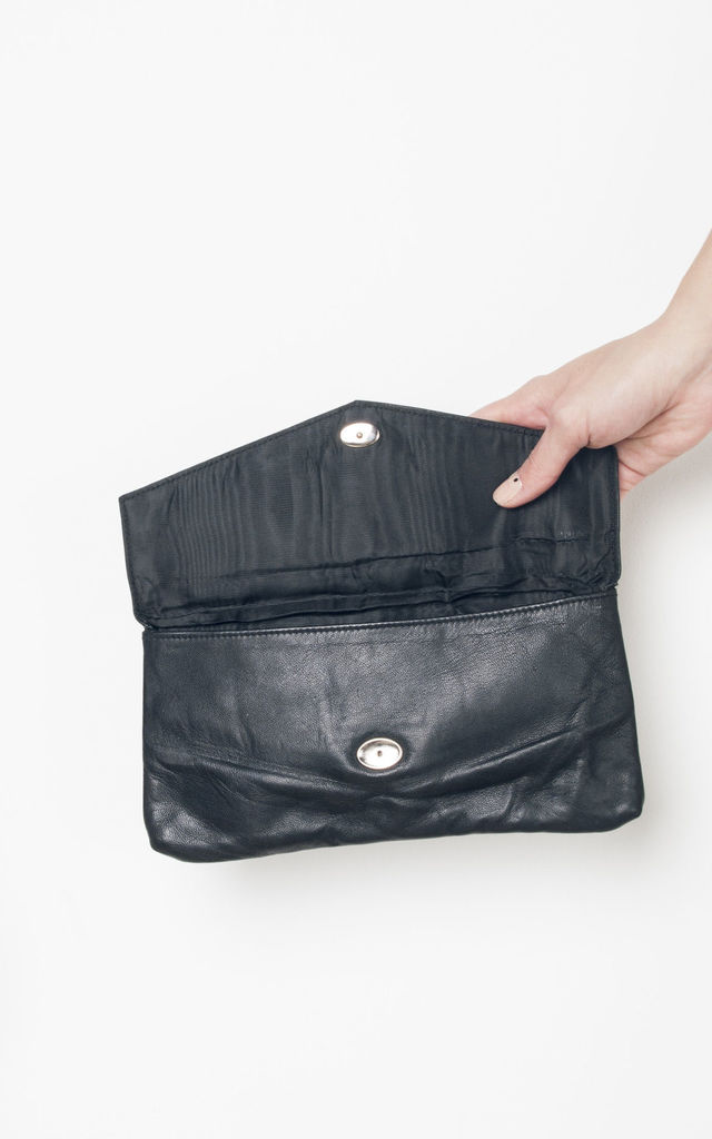 70s vintage leather clutch by Pop Sick Vintage