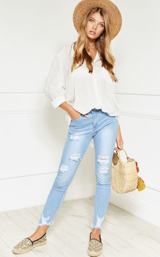 Light Blue Mid Rise Denim Skinny Ripped Jeans with Frayed Edge by Bella and Blue