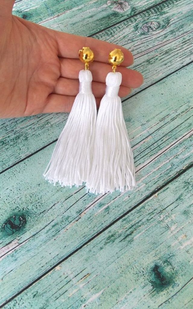 White Clip-On Tassel Earrings by Olivia Divine Jewellery