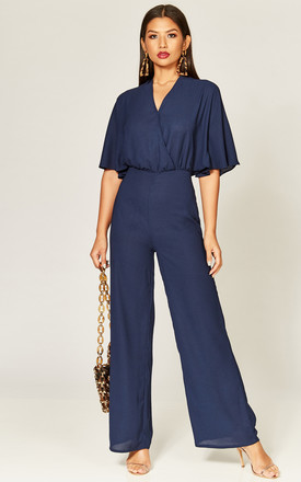 Navy Cape Sleeve Wrap Front Jumpsuit by Phoenix & Feather Product photo