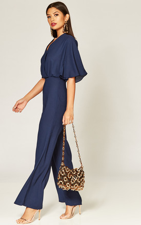 Navy cape sleeve wrap front jumpsuit by Phoenix & Feather