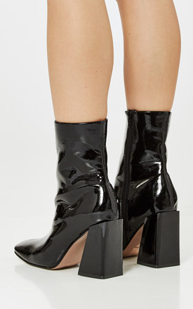 Black Crease Patent Asymmetric Block Heel Boots by Truffle Collection