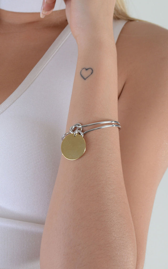 Silver Knot Bangle With Gold Disc Pendant by LOVEMYSTYLE