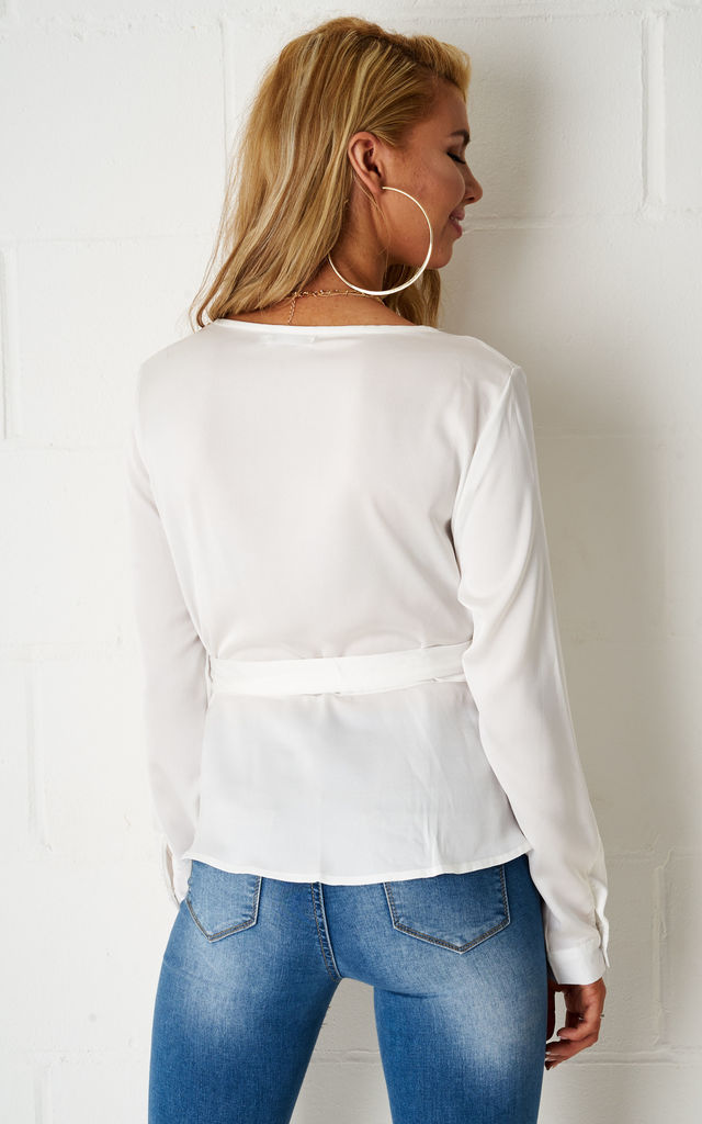 Penny Wrap Long Sleeve Top In White by love frontrow