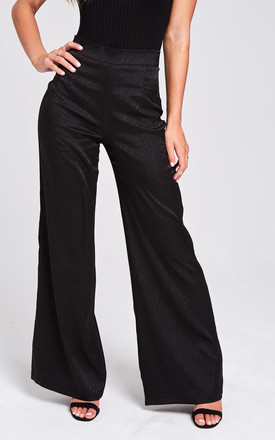 Nomad Black Animal Print Satin Trousers by Rogue Fox