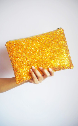 Glitter Clutch Bag In Burnt Orange by Suki Sabur Designs Product photo