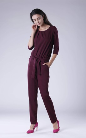Belted Long Sleeve Jumpsuit in Maroon by Bergamo