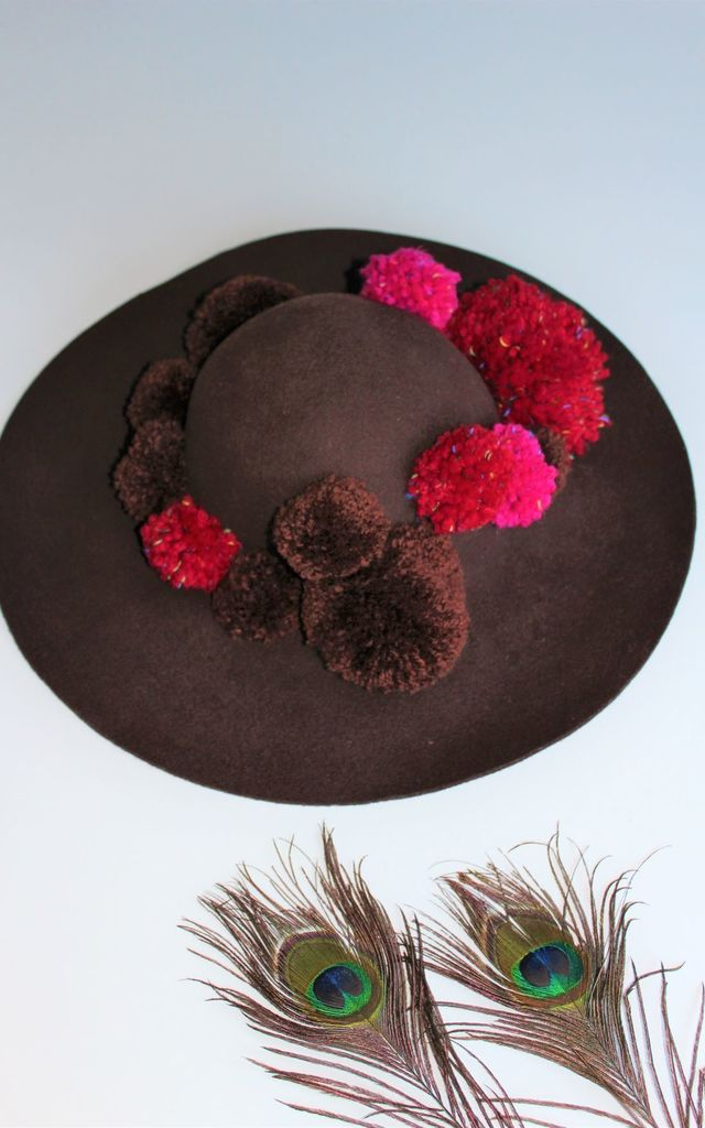 Binky brown floppy hat with mixed pom poms by Kate Coleman