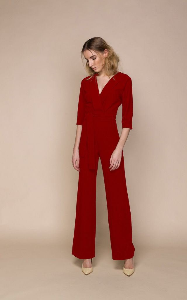Red Jumpsuit With Plunging Neckline by ACURRATOR