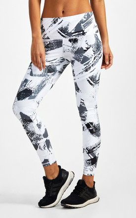 Leggings in Black and White Paint Stroke Print by GYMVERSUS London