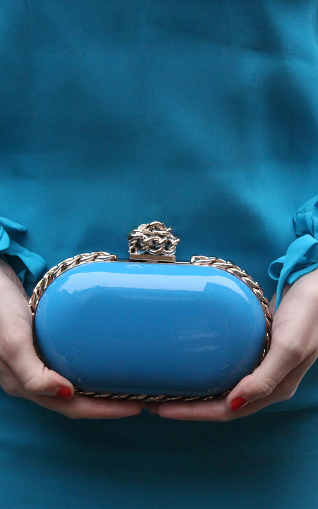 ble oval chain detail evening patent clutch bag by Hello Handbag