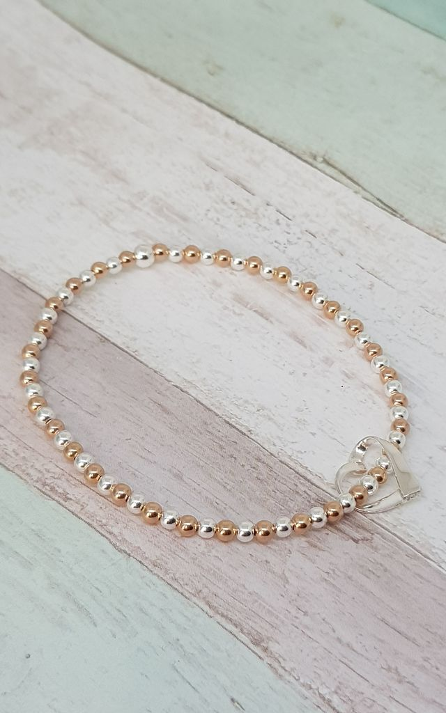 Sterling Silver & Rose Gold Floating Heart Bracelet by Kelly England Handmade Jewellery