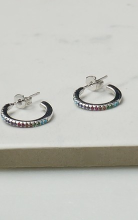 Silver rainbow huggie hoops by EPITOME JEWELLERY