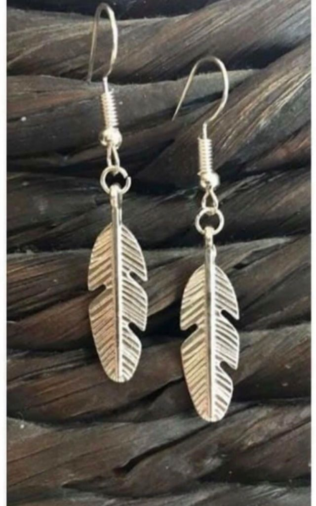 Silver boho feather earrings by Lovelock jewels