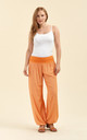 Slouchy pants in orange by From London with Love