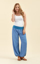 Slouchy pants in light blue by From London with Love