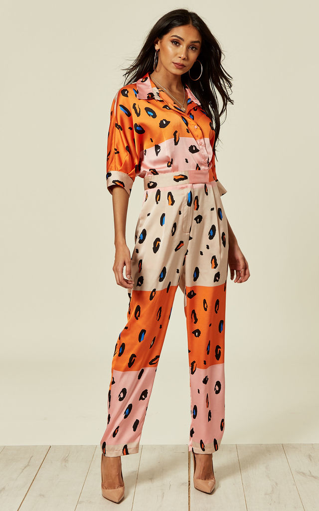 Jumpsuit with belt in contrasting orange leopard print by Liquorish