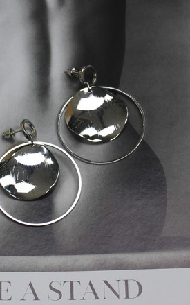 Silver Disc Swing Earrings by HAUS OF DECK