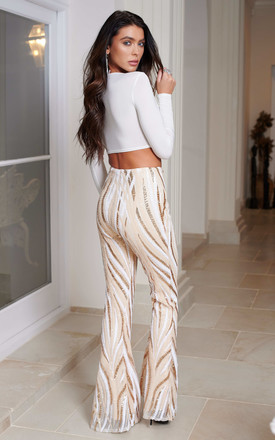 Cream Swirl Sequin Kick Flare Trousers by Club L London