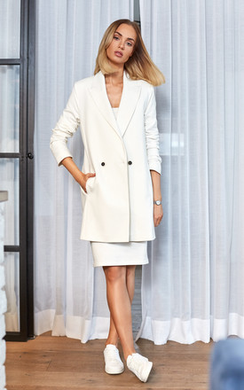 Long double-breasted blazer in white by MOE
