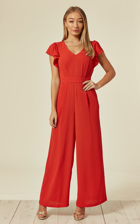 Edge of Reason Coral Frill Jumpsuit by Traffic People