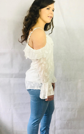 Long Sleeved Cold Shoulder Blouse With Ruffles In White Leaf Pattern by Pink Lemonade Boutique Product photo