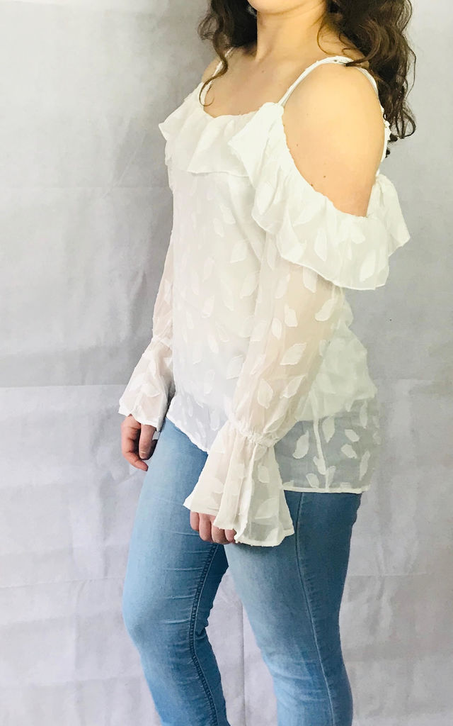 Long Sleeved Cold Shoulder Blouse with Ruffles in White Leaf Pattern by Pink Lemonade Boutique