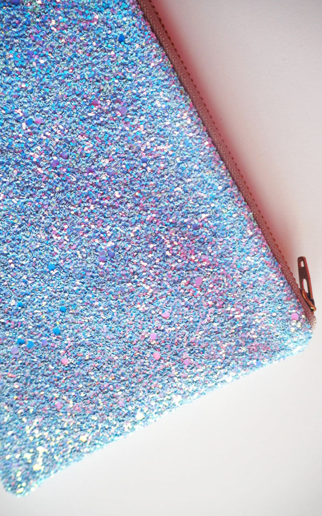 Glitter Makeup Bag in Shimmering Blue by Suki Sabur Designs