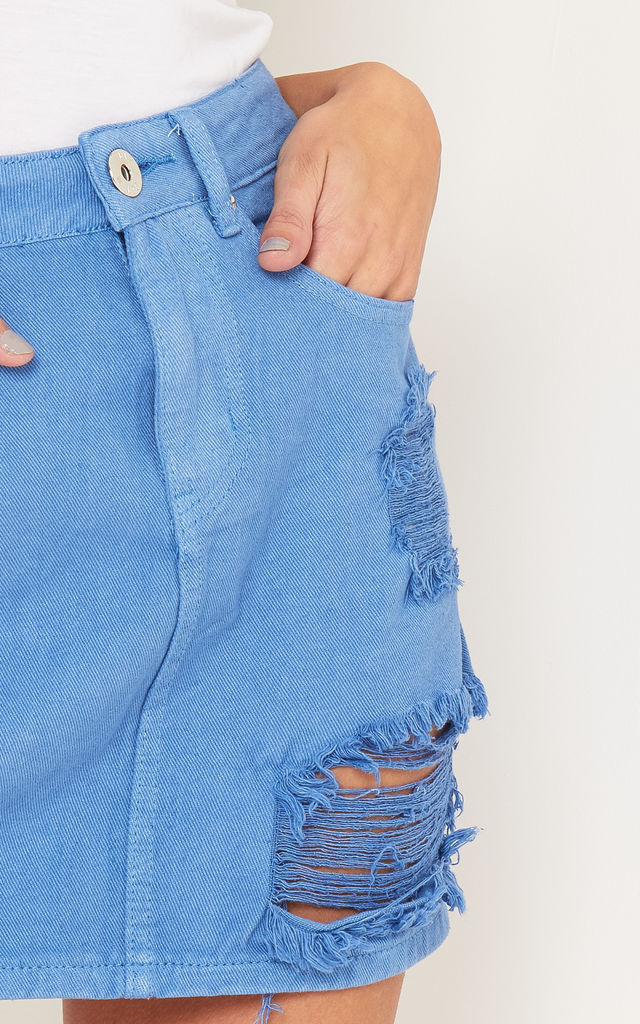 Distressed denim mini skirt in solid blue by LIQUOR N POKER