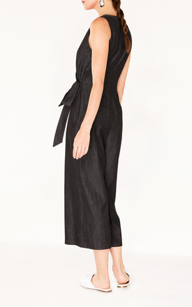 Cropped  Denim Jumpsuit with Front Overlay and Side Tie in Denim Black by Paisie