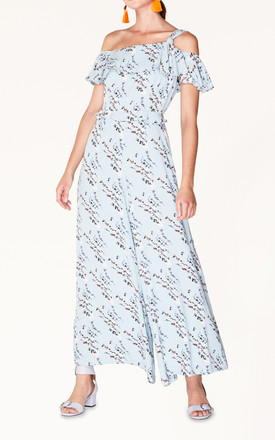 Floral Jumpsuit with Knot Shoulder and Ruffle Overlay in Light Blue Floral by Paisie
