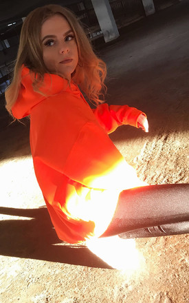 Oversized Hoodie in Neon Orange by Save The People