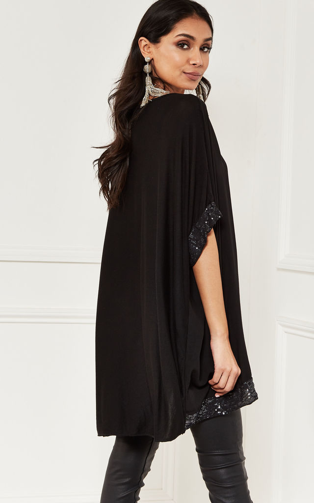 Oversized Sequin Hem Top in Black by Bella and Blue