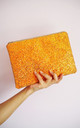 Glitter Clutch Bag in Rust Orange by Suki Sabur Designs