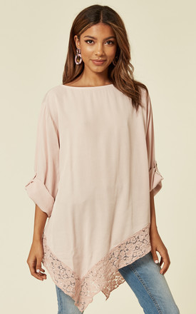 ALAYNA – Oversized Top with Asymmetric Lace Detail Hem in Blush Pink by Blue Vanilla